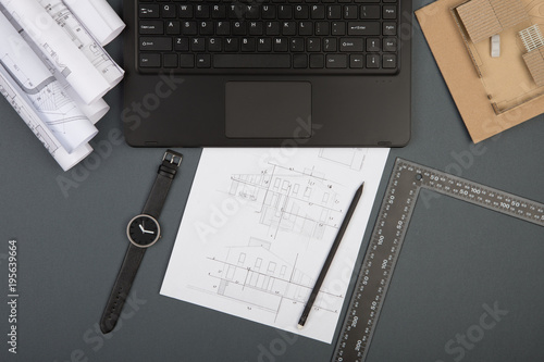 Fototapeta Workplace of architect - construction drawings, scale model and tools