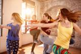 Fototapety Dancers dancing in dancing studio