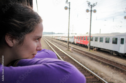 Young woman looking through the window of a train