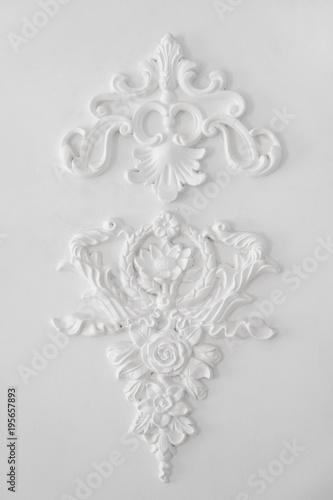 Elegant fretwork on white wall - 195657893