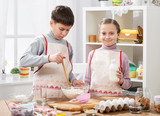 Girl and boy cooking in home kitchen, making the dough for baking, healthy food concept - 195658297