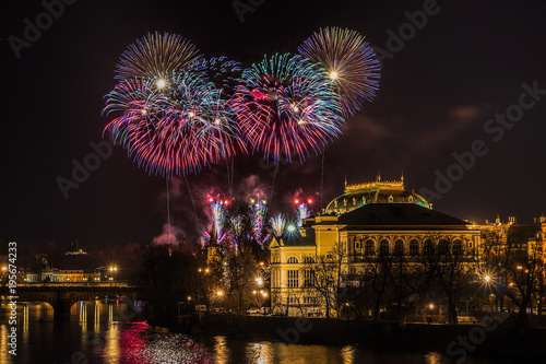 Staande foto Praag New Year Prague fireworks 2018 over river Vltava, National Theater and historic architecture.