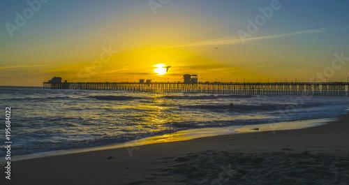 Fotobehang Strand oceanside sunset