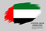 Grunge styled flag UAE. Brush stroke background