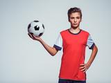Photo of teen boy in sportswear holding soccer ball - 195704696