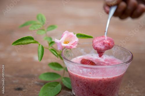 Foto op Plexiglas Milkshake Strawberry milk and rose on wood table