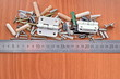Kit of wooden, metal and plastic furniture parts and ruler on the board