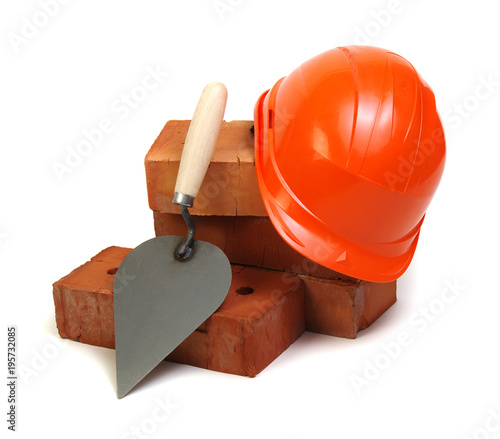 Fototapeta Brick, red hard hat and tools