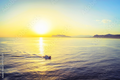 Staande foto Zwavel geel Sunrise and ship at Mediterranian sea at Palermo