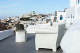 White terrace with armchair and view of Oia town in Santorini - 195746273