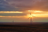 Wind power stations. Wind power is the use of air flow through wind turbines to mechanically power generators for electric power.  - 195750202