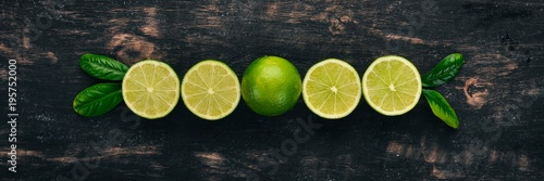 Fresh Green Lime. Fruits. On a wooden background. Top view. Copy space. - 195752000