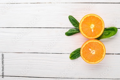 Foto op Canvas Sap Fresh Orange. Fruits. On a wooden background. Top view. Copy space.