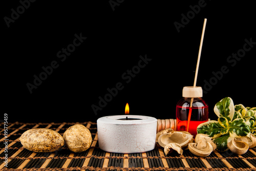 Foto op Canvas Spa Spa still life with aromatic candles over black background