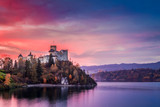 Beautiful castle by the lake at pink dusk, Poland