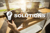 Business solutions concept on the virtual screen.