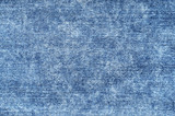 Jeans in acid wash blue. Denim background, texture, close up. Faded wash - 195819248
