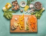 Asian tasty ingredients on cutting board:  Mu Err Mushrooms , ginger, various vegetables , pok choi , coconut milk and lemongrass , top view, copy space. Vegetarian or vegan asian cuisine - 195826876