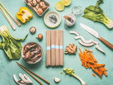 Asian food flat lay with tasty ingredients: Mu Err Mushrooms , various vegetables , pok choi , coconut milk, lemongrass and noodles , top view, copy space. Vegetarian or vegan asian cuisine - 195828643