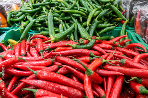 Deurstickers Hot chili peppers red and green pepper on the market