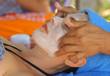 outdoor beach thai face head massage