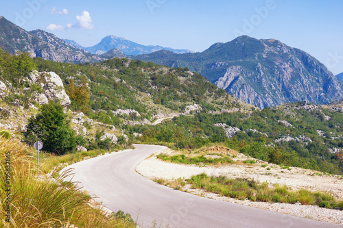 Keuken foto achterwand Blauwe hemel Summer mountain landscape with a winding country road. Dinaric Alps, Montenegro