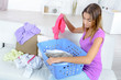 woman sorting the fresh laundry