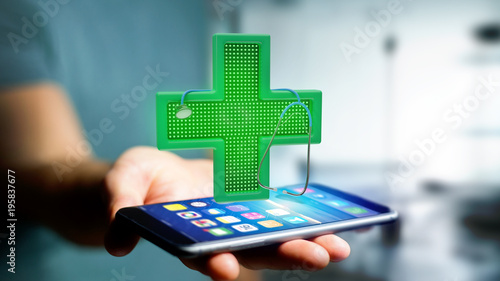 Papiers peints Pharmacie Businessman using a smartphone with a Lighting pharmacy cross and a stethoscope - 3d render