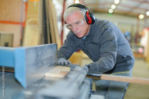 Man using woodworking machine - 195838037