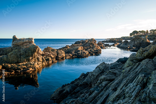 Foto op Canvas Zen Felsenküste im romantischen Sonnenuntergang