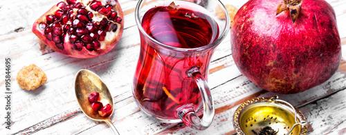 Fototapeta Cup of pomegranate tea