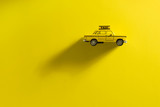 Taxi cab on a yellow background. - 195845238