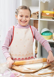 Girl cooking in home kitchen, making dough, healthy food concept - 195851856