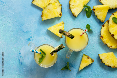 Aluminium Milkshake Homemade refreshing fruit beverage with pineapple, fresh vitamins. Cold summer drink. Copy space, top view flat lay background.