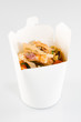 Chinese noodles in white box on isolated background with a chicken and vegetables