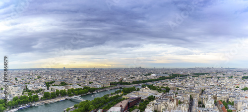 Poster Parijs Panoramic image of Beautiful cityscape of Paris from The Eiffel Tower viewing Basilica of the Sacred Heart of Paris in distance in twilight , France