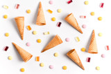 Ice cream cones and candy flat lay image with copy space.