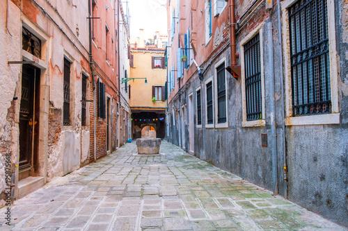 Fototapeta Narrow street in Venice