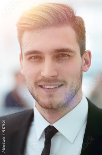 successful businessman on blurred background.