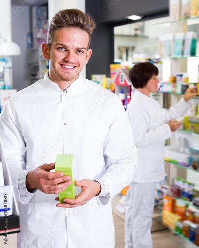 Foto op Plexiglas Apotheek Portrait of two glad adult pharmacists
