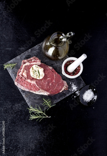 Fotobehang Steakhouse Steak on slate board with herbs