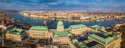 Foto op Aluminium Boedapest Budapest, Hungary - Aerial skyline view of the famous Buda Castle Royal Palace at Castle District with Szechenyi Chain Bridge and other landmarks at background. Blue sky with clouds