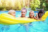 Kids have fun at the pool - 195884055