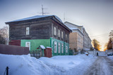 Old houses in ancient Russian city of Kolomna, Moscow region, Russia, after snowfall. Winter overcast day.