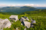 beautiful mountain landscape on summer morning. boulders among the grass on hillside - 195892865