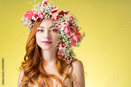 Fototapeta woman with wearing a wreath of tulips