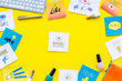 Beauty blogging concept. Work desk with keyboard, cosmetics and social media icons on yellow desk top view