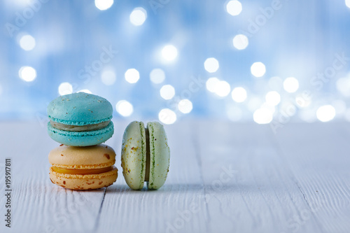 multicolored macaroons on a background of light bulbs Poster