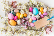 Easter holiday background.Easter eggs sweets and spring flowers background copy space.