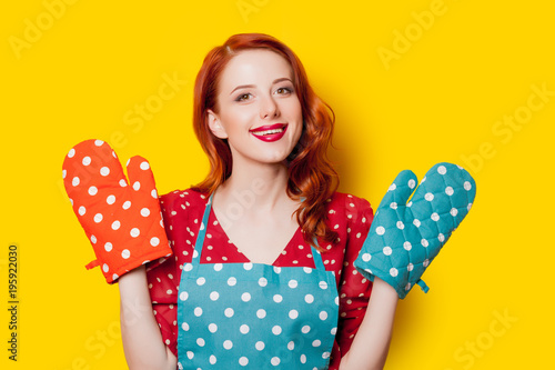 Redhead housewife with gloves and apron